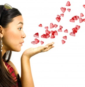 Girl Blowing Red Hearts To Her Lover For Valentines